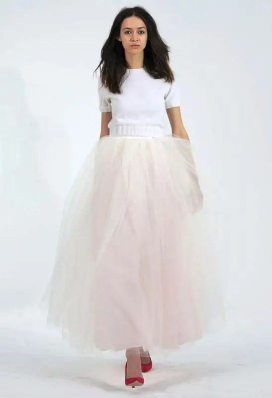 a short sleeve white sweater and a blush tulle skirt for a modern and simple bridal look
