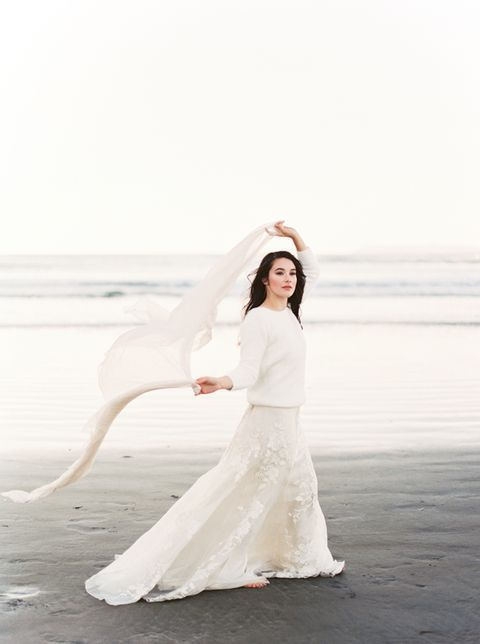 fca1f404c00 a romantic white lace dress and a white chunky knit sweater for a winter  coastal bride