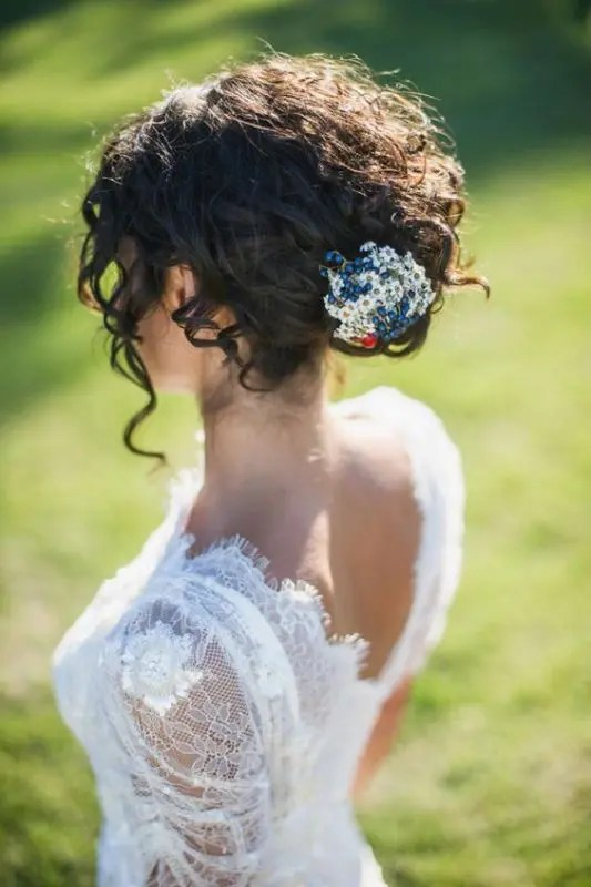 a curly updo with a bead and sequin hairpiece and some bangs is romantic and very chic