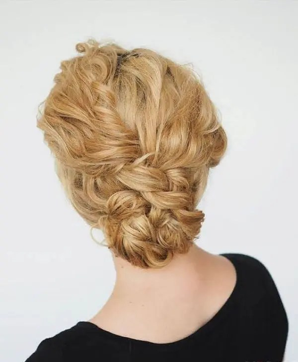 a curly double braided low bun is great for many bridal styles, from more romantic to boho ones