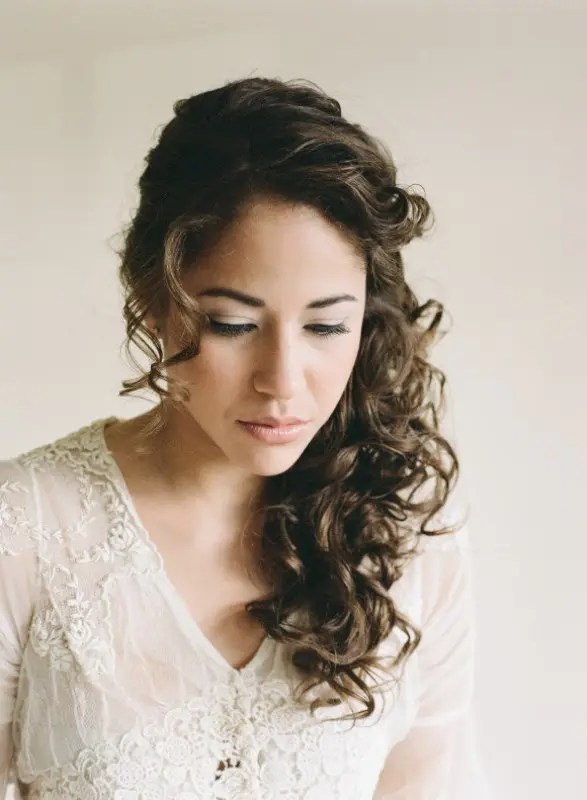 a side half updo with curls and bangs is a chic and very girlish idea of a wedding hairstyle