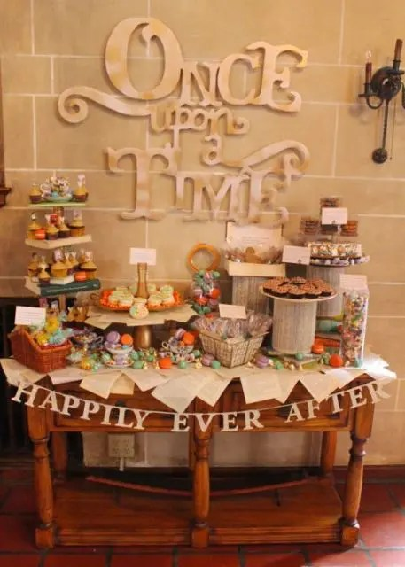 a bright and fun Disney-themed dessert table with quotes, book pages and figurines