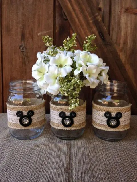 jars wrapped with burlap and lace plus large buttons that make up Mickey Mouse heads
