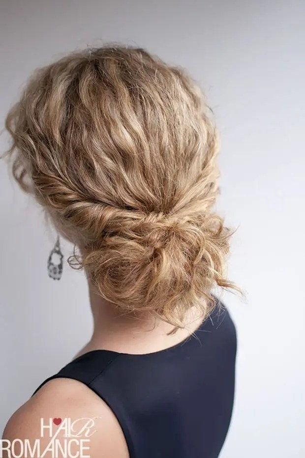 a low bun with straightened hair and locks down is an exquisite option to rock at a wedding