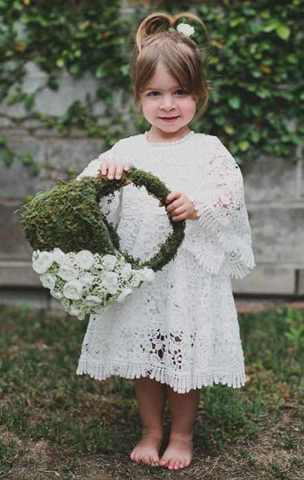 a moss flower girl basket with white berries and blooms is a stylish idea with a boho feel