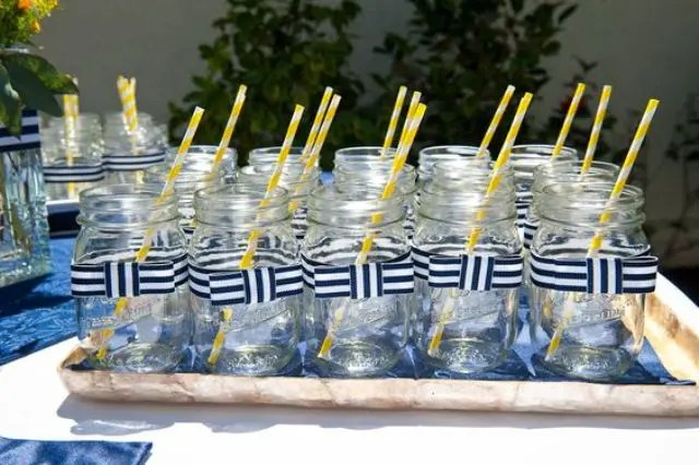 mason jars with striped bows and yellow straws are perfect for serving cocktails at the party