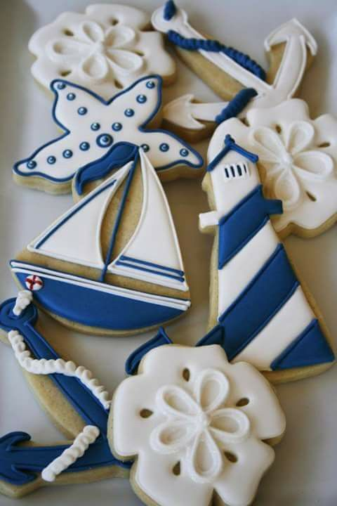 stylish nautical themed cookies with navy and white glazing are amazing for a nautical themed shower