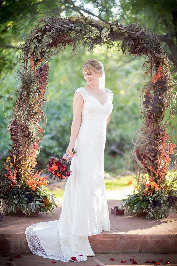 moody dark fall wedding arch