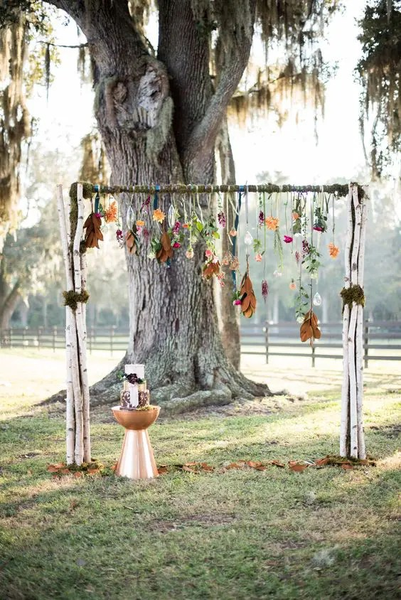 boho fall arch with hanging flowers and leaves