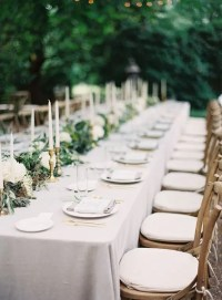 Picture Of neutral outdoor tablescape with candles