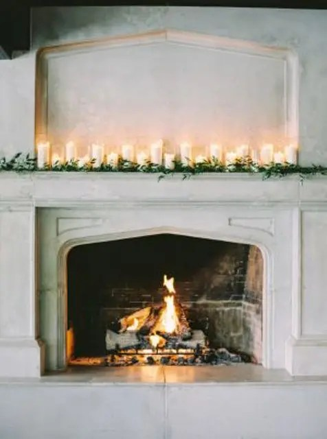 decorate the fireplace mantles with candles and baby