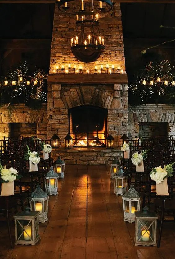 working candlelit fireplace used an altar to maximize coziness at a rustic wedding