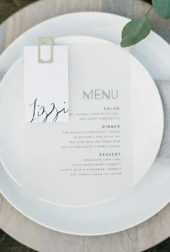 simple modern place setting with a printed menu and neutral dishes