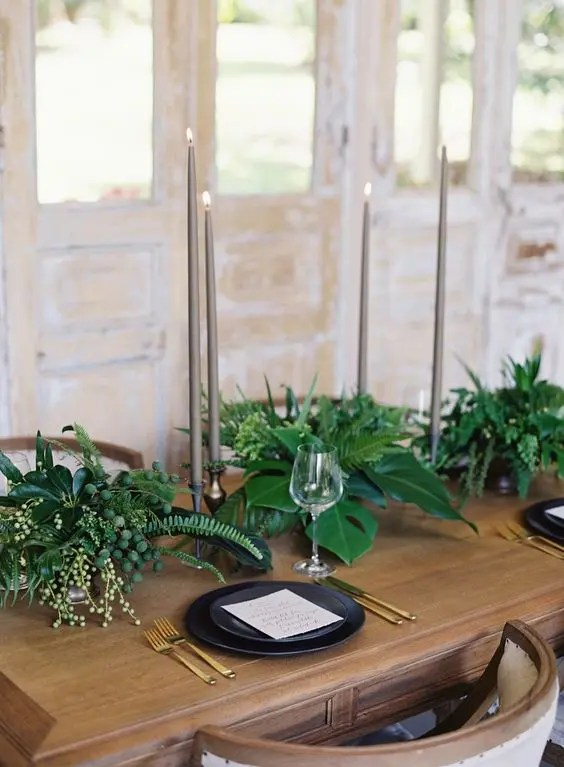tropical minimalism with botanicals, black dishes and tall candles