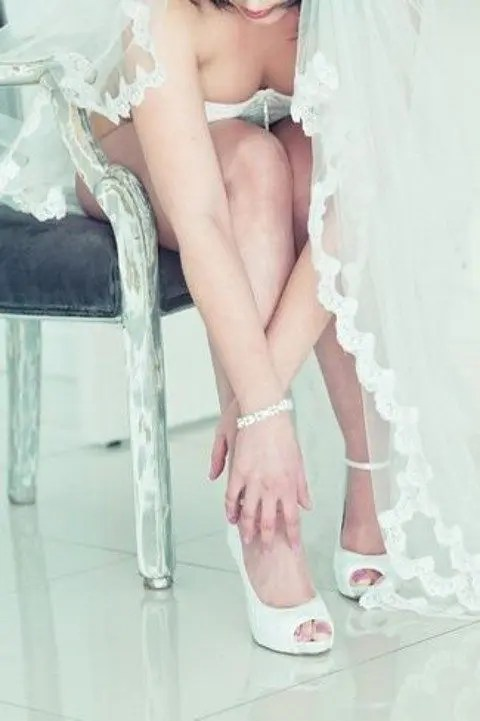 chic white peep toe shoes and a veil