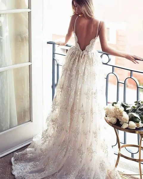 show off your backless wedding dress on a balcony
