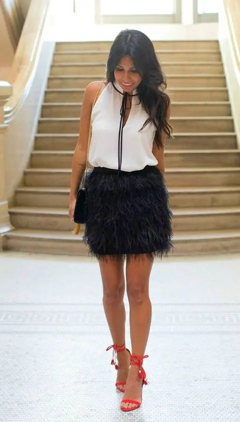 black feather mini, a white top and red heels to make a statement