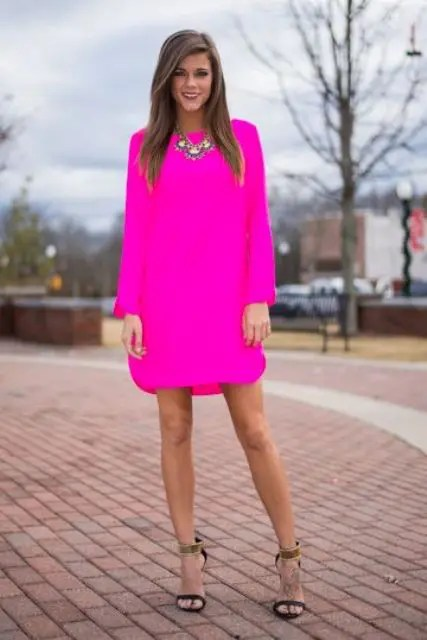 neon pink dress, ankle strap heels and a statement necklace