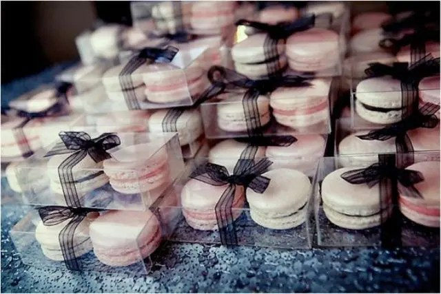 blush and ivory macarons tied with black ribbon