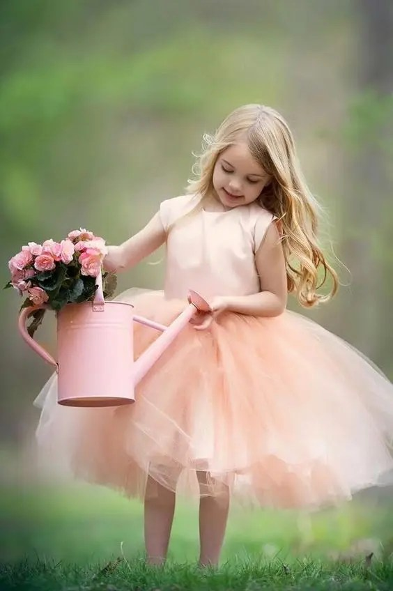 peach-colored flower girl dress with a tutu skirt