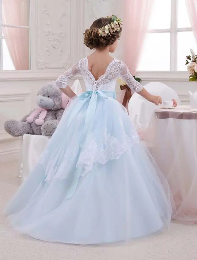 V lace back and a layered light blue skirt