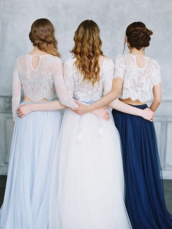 white lace crop tops and a light blue and navy maxis for bridesmaids