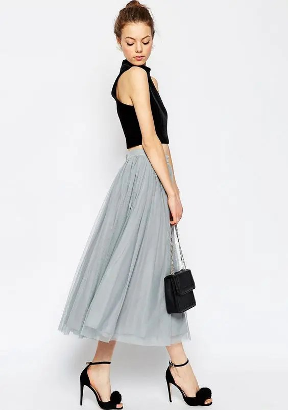 a dove grey tulle midi skirt and a black crop top