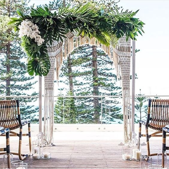 macrame, pal leaves and white orchids for a tropical boho wedding