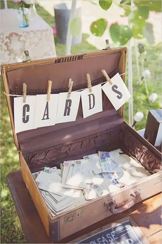 an old suitcase is an easy and fast solution that will fit not only a rustic but also a vintage wedding