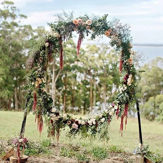 fall boho giant wreath with lots of greenery and blush and burgundy flowers