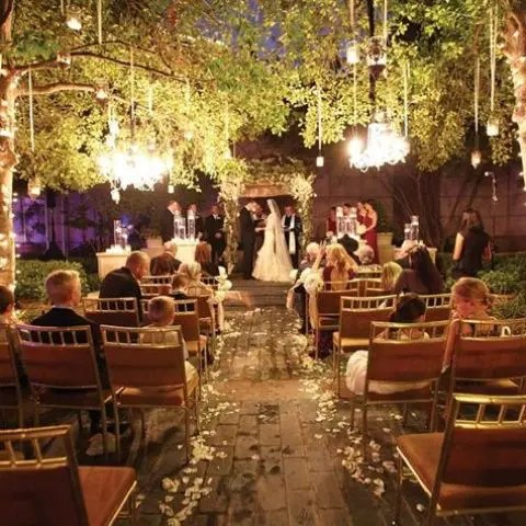 Crystal Chandeliers And Candle Holders Hanging Over The Whole Ceremony E
