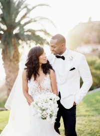 Picture Of The groom was wearing a white tuxedo with a bow tie