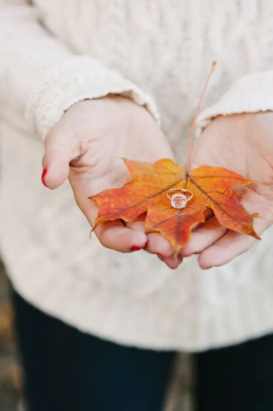 show off your engagement ring on a colorful fall leaf