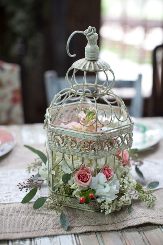 Picture Of a shabby chic bird cage with white pink and blush florals