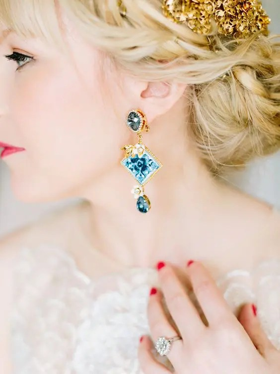 statement gold and blue earrings for a daring bride for something blue