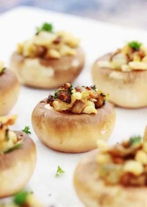 stuffed champignons with ham, cheese and greenery are amazing as finger food