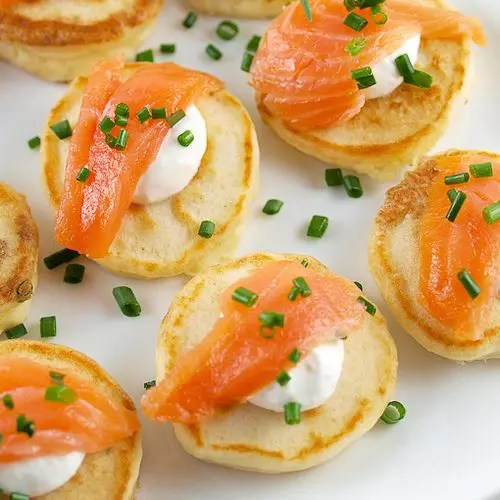 cream cheese pancakes with smoked salmon and greenery are a fresh take on salmon bites