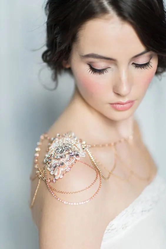 rose gold shoulder piece with rhinestones for a chic bridal look