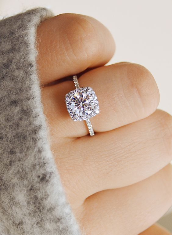 a delicate cushion shaped halo diamond engagement ring is a timeless and chic solution that many girls will like