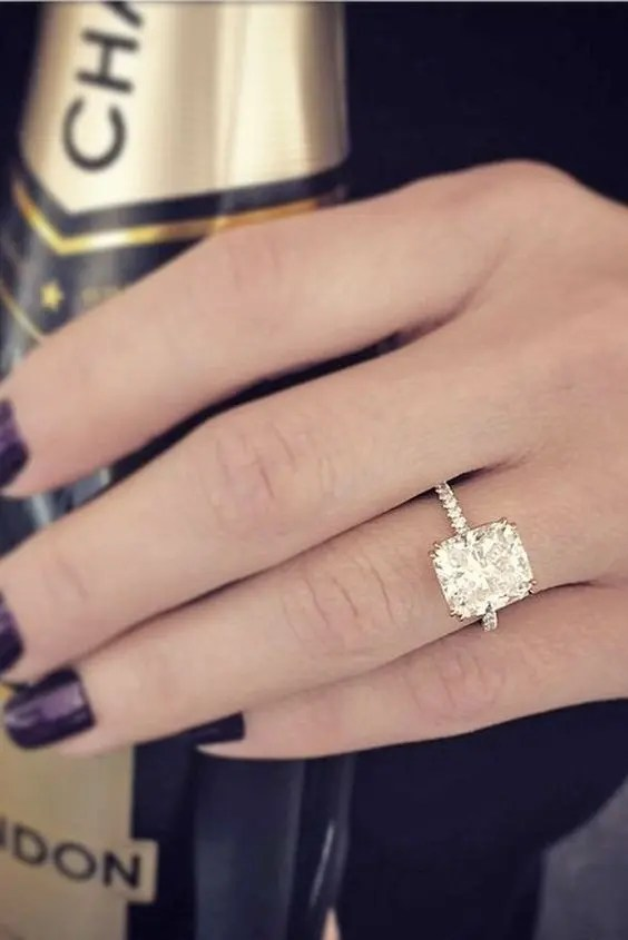 a gold engagement ring with a large square diamond is a stylish idea to try