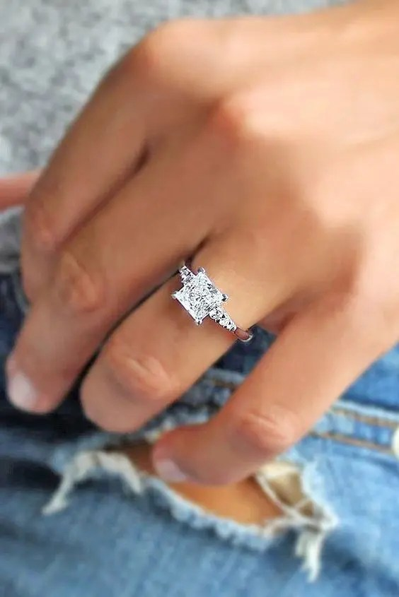 a white gold modern engagement ring with a square diamond and no halo looks bold and edgy