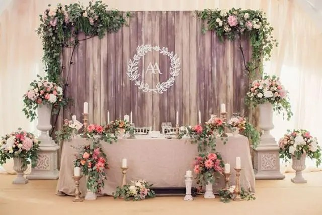 a wooden backdrop with lush foliage and blooms for an elegant vintage look