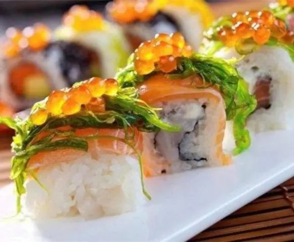 sushi topped with greenery and caviar is always a good idea whatever your wedding style and venue is