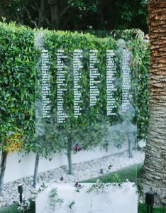 large acrylic seating chart on white wooden block with fresh greenery and flowers also modern creative ideas weddingomania rh