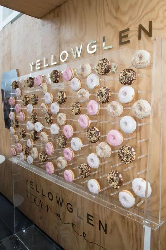 a clear acrylic donut wall for a modern glam wedding