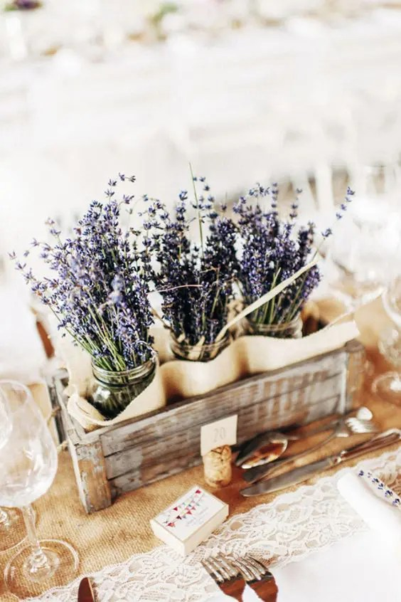 a wooden crate with lavender in jars fits not only a Provence wedding
