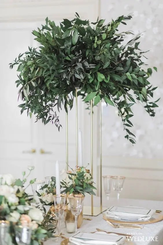 a tall eucalyptus centerpiece on a gilded frame to save some table space