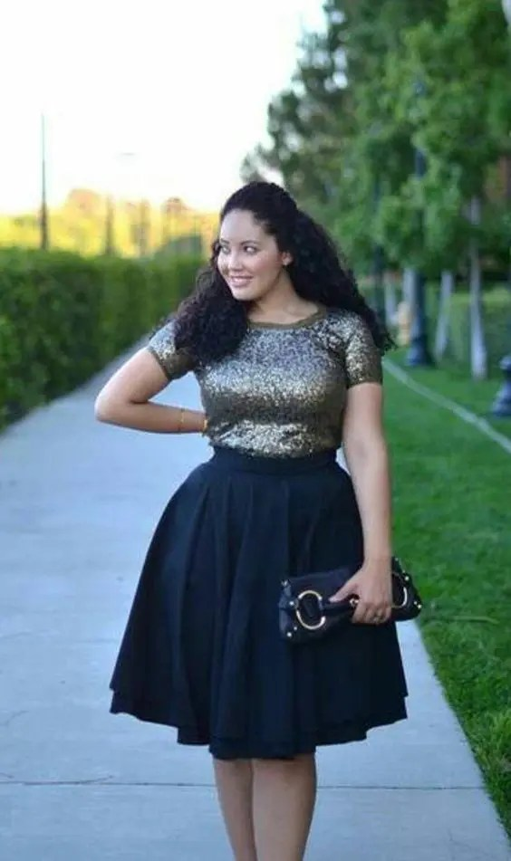 an ensemble of a dark sequin top with short sleeves and a full black A-line skirt