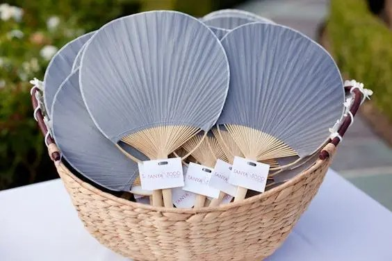 fan wedding favors is an elegant and inexpensive way to take care of your guests on a hot day