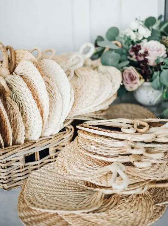 elegant wicker fans are a great way to make the guests feel comfortable and remind of your wedding later, too